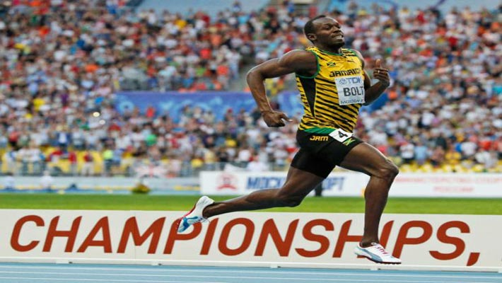 Usain Bolt cruises to third straight 200-meter world title