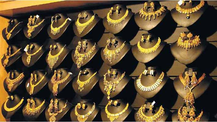 Gold futures hit record high of Rs. 34,500 per 10 gram