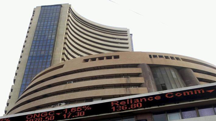 Sensex closes at fresh three year high of 20,894