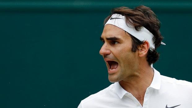 I'll be back at Wimbledon, vows beaten Federer